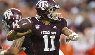 FILE - In this Sept. 8, 2018, file photo, Texas A&M quarterback Kellen Mond (11) passes down field against Clemson during the first half of an NCAA college football game, in College Station, Texas. Mond turned heads by throwing for a career-high 430 yards as the Aggies came just short of knocking off Clemson last week. (AP Photo/Sam Craft, File)