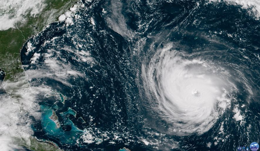 This GOES East satellite image taken Tuesday, Sept. 11, 2018, at 10:30 a.m. EDT, and provided by NOAA shows Hurricane Florence in the Atlantic Ocean as it threatens the U.S. East Coast, including Florida, Georgia, South and North Carolina. Millions of Americans are preparing for what could be one of the most catastrophic hurricanes to hit the Eastern Seaboard in decades. Mandatory evacuations begin at noon Tuesday, for parts of the Carolinas and Virginia (NOAA via AP)
