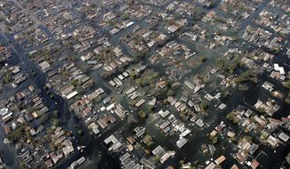 FILE - In this Sept. 11, 2005, file photo, homes remain surrounded by floodwaters in the aftermath of Hurricane Katrina in New Orleans. Some experts are concerned that Hurricane Florence could inflict damage comparable to 2005's Hurricane Katrina in a part of the country that is famously difficult to evacuate, months after disaster planners simulated a Category 4 Hurricane strike alarmingly similar to the real-word scenario now unfolding on a stretch of the East Coast. (AP Photo/David J. Phillip, Pool, File)