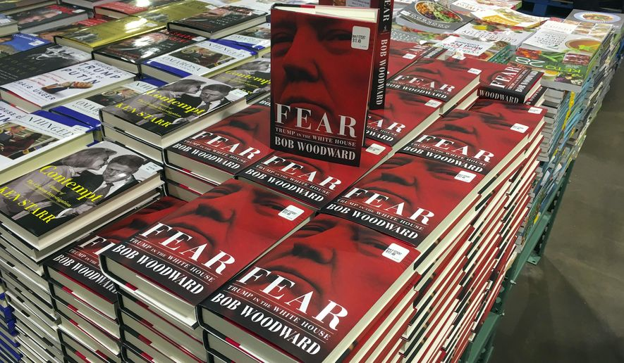 "Copies of Bob Woodward's ""Fear"" are seen for sale at Costco, Wednesday, Sept. 11, 2018 in Arlington, Va. It's not clear whether President Donald Trump has much to fear from ""Fear"" itself. But the book of that name has set off a yes-no war between author Bob Woodward and the president, using all the assets they can muster. (AP Photo/Pablo Martinez Monsivais)"