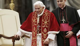"""FILE - This Feb. 9, 2013 file photo shows Pope Benedict XVI flanked by personal secretary Archbishop Georg Gaenswein during a Mass to mark the 900th anniversary of the Order of the Knights of Malta in St. Peter's Basilica at the Vatican. Archbishop Georg Gaenswein told a book presentation Tuesday, Sept. 11, 2018, that the sex abuse scandal that has convulsed the Catholic Church for years is """"its own 9/11."""" (AP Photo/Gregorio Borgia, files)"""