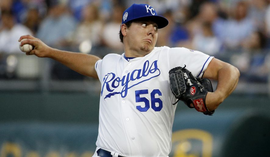 Kansas City Royals relief pitcher Brad Keller throws during the first inning of a baseball game against the Chicago White Sox, Tuesday, Sept. 11, 2018, in Kansas City, Mo. (AP Photo/Charlie Riedel)