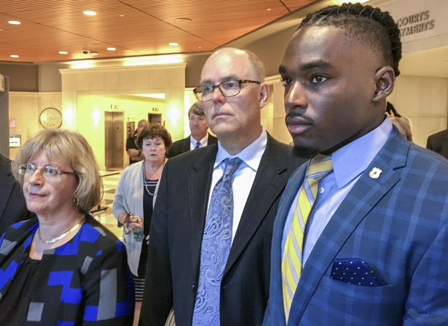 FILE - In this Aug. 23, 2018, file photo, University of Wisconsin wide receiver Quintez Cephus, right, with his attorneys Kathleen Stalling, left, and Stephen Meyer after appear in court in Madison, Wis. Prosecutors have charged Cephus with second- and third-degree sexual assault. Cephus is scheduled to appear in court Tuesday, Sept. 11, 2018, for a preliminary hearing, during which a judge is expected to decide whether the case is strong enough to proceed to trial. (Ed Treleven/Wisconsin State Journal via AP, File)