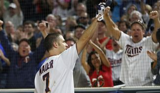 Minnesota Twins' Joe Mauer doffs his helmet after a curtain call following his his grand slam off New York Yankees pitcher Tommy Kahnle in the fifth inning of a baseball game Tuesday, Sept. 11, 2018, in Minneapolis. (AP Photo/Jim Mone)