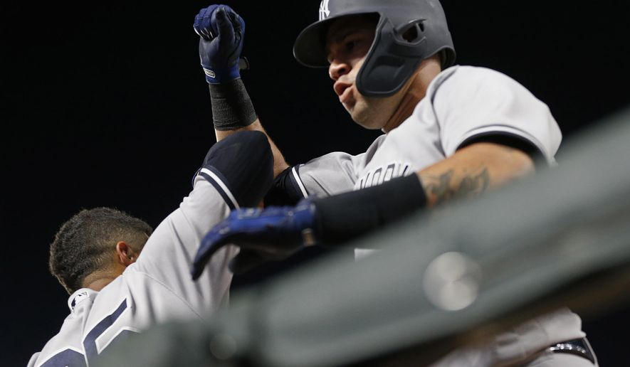 New York Yankees' Gary Sanchez, right, celebrates his solo home run off Minnesota Twins pitcher Kyle Gibson with Gleyber Torres in the dugout during the sixth inning of a baseball game Monday, Sept. 10, 2018, in Minneapolis. (AP Photo/Jim Mone)