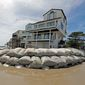 Sand bags surround homes on North Topsail Beach, North Carolina, on Wednesday as Hurricane Florence threatens the coast. As much as 35 inches of rain is expected. (ASSOCIATED PRESS)