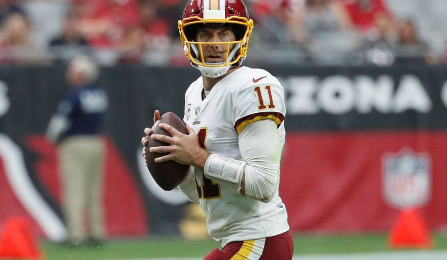 Washington Redskins quarterback Alex Smith threw for 255 yards with a 70 percent completion rate for two touchdowns in Sunday's win over the Arizona Cardinals. (ASSOCIATED PRESS)