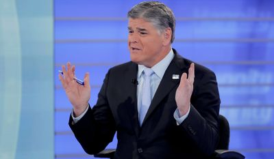 """Fox News talk show host Sean Hannity interviews Roseanne Barr during a taping of his show, Thursday, July 26, 2018, in New York. Barr will appear on the Fox News show """"Hannity"""" on Thursday at 9 p.m. EDT for the first time since she was fired from ABC and her namesake show was canceled. ABC canceled its successful reboot of """"Roseanne"""" in May following the star's racist tweet likening former Obama adviser Valerie Jarrett to a cross between the Muslim Brotherhood and a """"Planet of the Apes"""" actor. (AP Photo/Julie Jacobson)"""