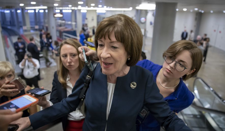 In this Aug. 21, 2018, file photo, Sen. Susan Collins, R-Maine, speaks with reporters on an escalator at the Capitol in Washington. (AP Photo/J. Scott Applewhite, File)