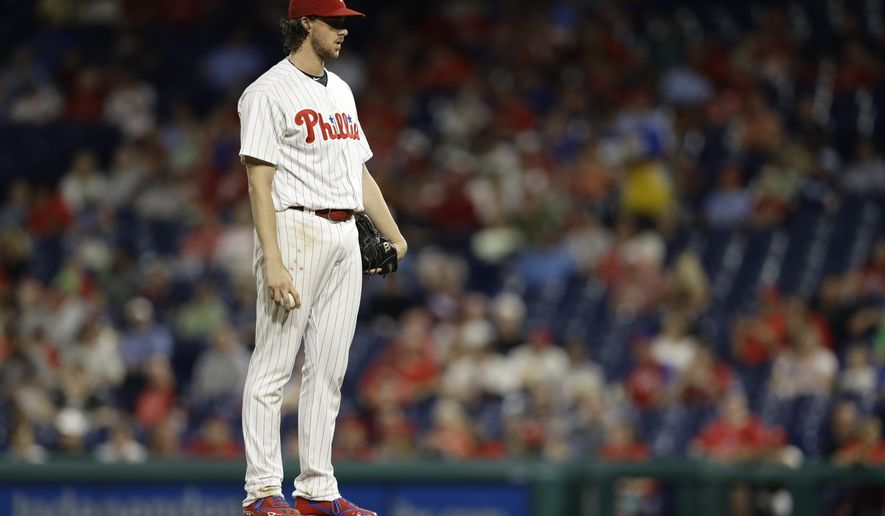 Philadelphia Phillies' Aaron Nola in action during a baseball game against the Washington Nationals, Wednesday, Sept. 12, 2018, in Philadelphia. (AP Photo/Matt Slocum)
