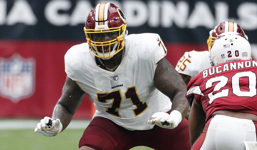 "FILE - In this Sept. 9, 2018, file photo, Washington Redskins offensive tackle Trent Williams (71) is shown in action during an NFL football game against the Arizona Cardinals, in Glendale, Ariz. A franchise known for the ""Hogs"" offensive line from the Super Bowl era, the Washington Redskins might have another season-altering group in the trenches this season. Led by left tackle Trent Williams, Washington's ""Hogs 2.0"" offensive line is a dream to play behind for running back Adrian Peterson and quarterback Alex Smith. (AP Photo/Rick Scuteri, File)"