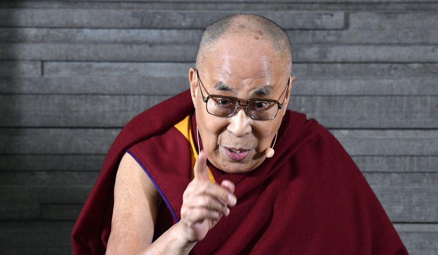 Tibetan spiritual leader the Dalai Lama speaks during a press meeting in Malmo, Sweden, Wednesday Sept. 12, 2018. (Johan Nilsson/TT via AP)
