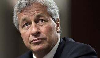 In this June 13, 2012, file photo, JPMorgan Chase CEO Jamie Dimon testifies before the Senate Banking Committee on Capitol Hill in Washington. Dimon, is saying he would be able to beat President Donald Trump in an election, but also says he isn't running for the nations top office. The nations most powerful banker told reporters at an event at JPMorgan headquarters Wednesday, Sept. 12, 2018, that he thinks he could beat Trump. (AP Photo/J. Scott Applewhite, File)