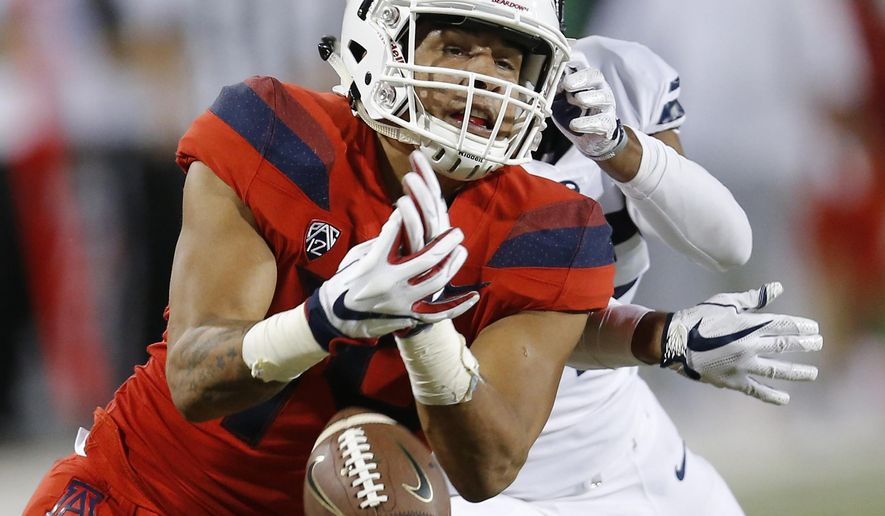 FILE - In this Sept. 1, 2018, file photo, Arizona wide receiver Shawn Poindexter (19) drops the ball in the second half during an NCAA college football game against Brigham Young, in Tucson, Ariz. Arizona was supposed to make a seamless transition to new coach Kevin Sumlin, possibly contend for a Pac-12 South title. Through two games, the Wildcats have done little but struggle under their first-year coach. (AP Photo/Rick Scuteri, File)