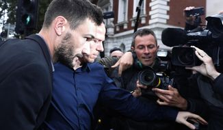English soccer team Tottenham Hotspur's French goalkeeper Hugo Lloris arrives at Westminster magistrates court to answer a charge of a drinking and driving offense, in London, Wednesday, Sept. 12, 2018. (AP Photo/Alastair Grant)