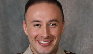 Scott County Deputy Jaime Morales is seen in an undated photo provided by the Scott County Sheriff's Office. A Florida bank robbery suspect tracked down at an interstate rest stop in Kentucky late Tuesday was killed in a late-night exchange of gunfire that left Morales critically wounded, authorities said Wednesday, Sept. 12, 2018. The fugitive, Edward Reynolds, died at the rest stop, Kentucky State Police Trooper Bernis Napier said. (Scott County Sheriff's Office via AP)