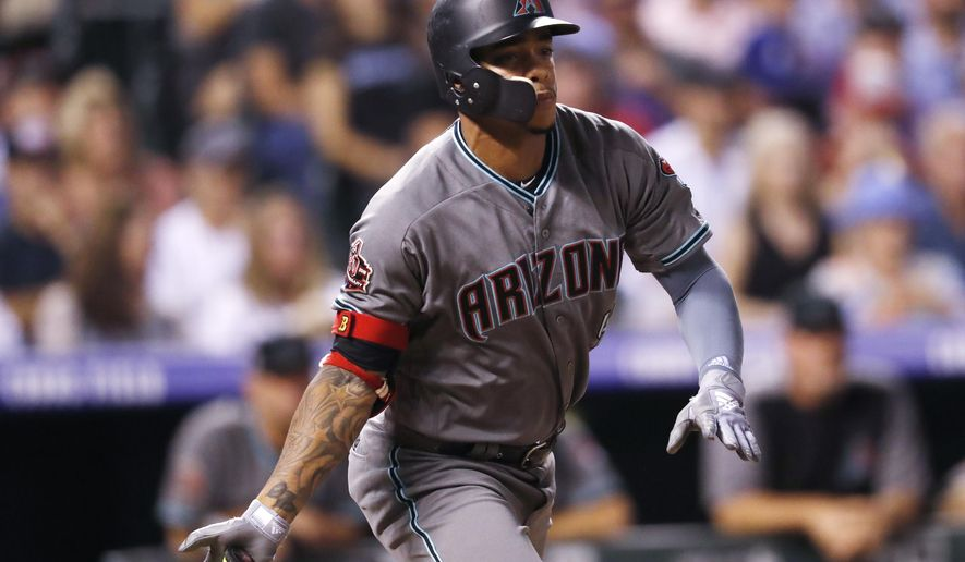 Arizona Diamondbacks' Ketel Marte follows the flight of his triple to drive in two runs off Colorado Rockies starting pitcher Antonio Senzatela in the sixth inning of a baseball game, Tuesday, Sept. 11, 2018, in Denver. (AP Photo/David Zalubowski)