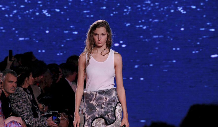 A model walks the runway at the Calvin Klein spring 2019 runway show during New York Fashion Week, Tuesday, Sept. 11, 2018. (AP Photo/Diane Bondareff)
