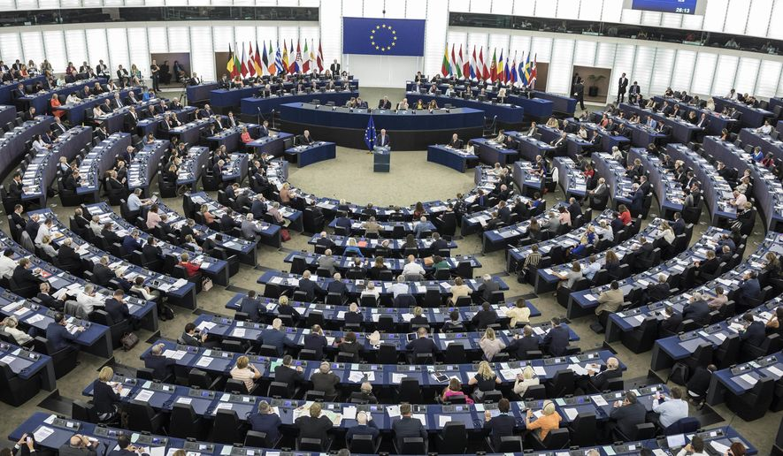 European Commission President Jean-Claude Juncker, center, delivers his State of Union speech at the European Parliament in Strasbourg, eastern France, Wednesday, Sept.12, 2018. (AP Photo/Jean-Francois Badias)