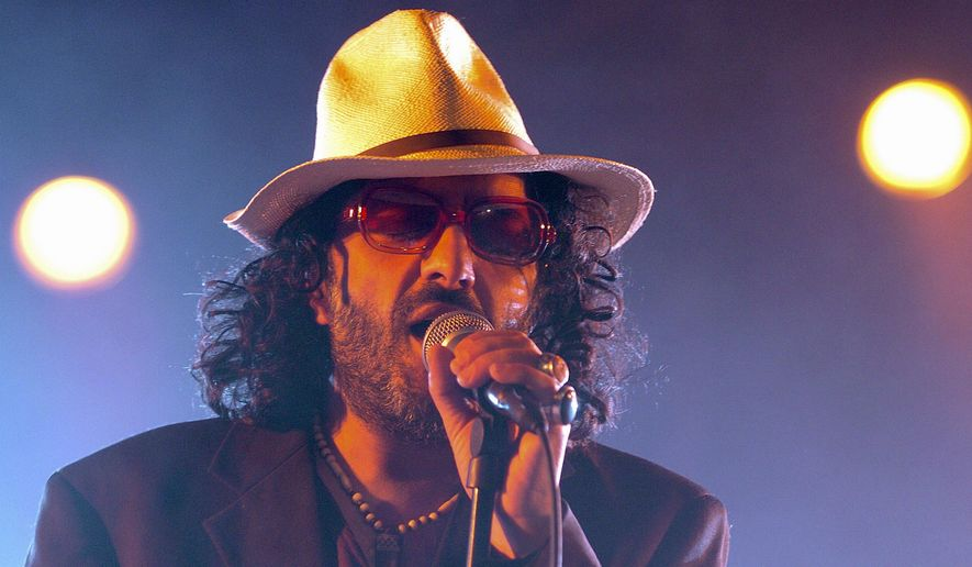 FILE - In this July 19, 2005 file photo, Algerian singer Rachid Taha sings on the main stage during the opening day of the Paleo Festival in Nyon, Switzerland. Rachid Taha, an Algerian singer who thrillingly blended Arabic music with rock and techno and at times wore blue contact lenses to protest anti-Arab prejudice in France, where he made his home, has died. He was 59. (Sandro Campardo, Keystone via AP, File)