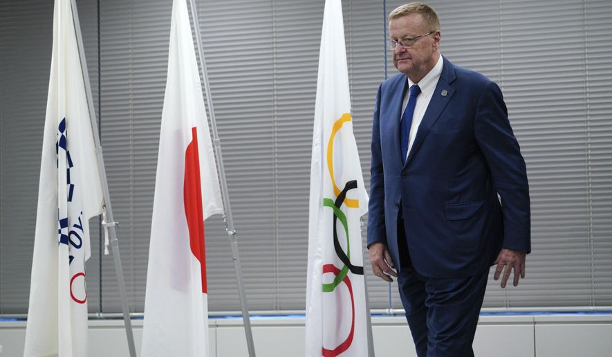 John Coates, chairman of the IOC Coordination Commission for the 2020 Tokyo Olympics and Paralympics leaves from the venue of the IOC and Tokyo 2020 joint press conference Wednesday, Sept. 12, 2018. (AP Photo/Eugene Hoshiko)