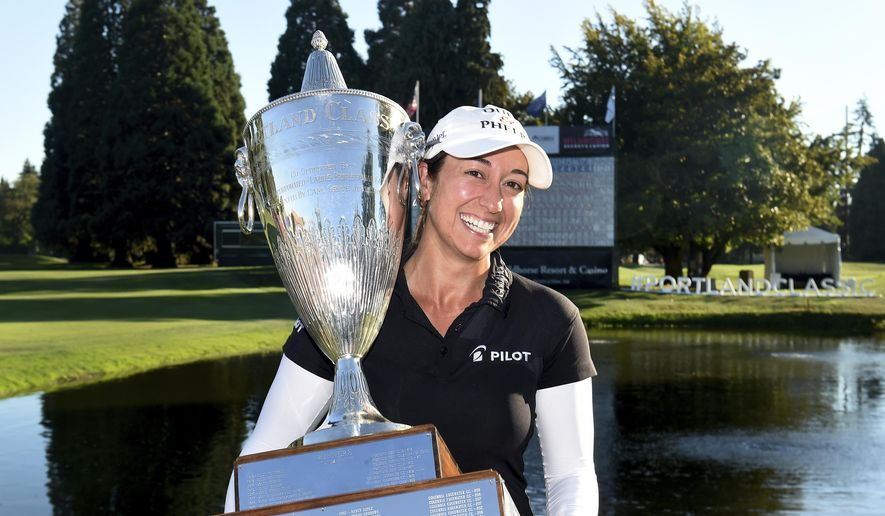 Marina Alex holds the trophy after winning the LPGA Cambia Portland Classic golf tournament in Portland, Ore., Sunday, Sept. 2, 2018. (AP Photo/Steve Dykes)