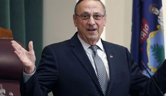 In this Feb. 13, 2018, file photo, Gov. Paul LePage delivers the State of the State address to the Legislature at the State House in Augusta, Maine. LePage confirmed to The Associated Press on Wednesday, Sept. 12, 2018, that he was transported via LifeFlight to a Bangor hospital in August while visiting family in New Brunswick, Canada. (AP Photo/Robert F. Bukaty, File)