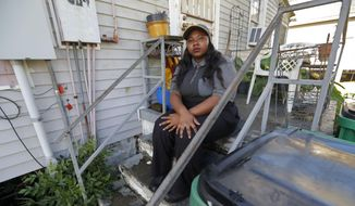 Tanya Harrell poses for a photograph in her McDonalds work uniform before her shift, outside her home in Gretna, La., Wednesday, Sept. 12, 2018. McDonald's workers have voted to stage a one-day strike at the company's restaurants in some cities in hopes of pressuring management to take stronger steps against on-the-job sexual harassment. Organizers say it will be the first multi-state strike in the U.S. specifically targeting sexual harassment. (AP Photo/Gerald Herbert)
