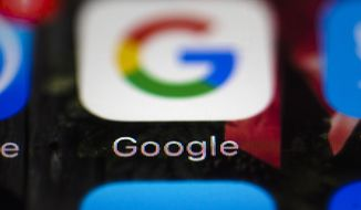 FILE- This April 26, 2017, file photo shows a Google icon on a mobile phone in Philadelphia. New Mexico is suing Google, Twitter and other companies that develop and market mobile gaming apps for children, saying the apps violate state and federal laws by collecting personal information that could compromise privacy. The lawsuit filed in federal court late Tuesday, Sept. 11, 2018, comes as data-sharing concerns persist among users. (AP Photo/Matt Rourke, File)