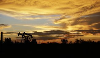 """FILE- In this June 5, 2017, file photo pumpjacks work in an oil field at sunset after a thunderstorm passed through the area in Karnes City, Texas. The United States may have reclaimed the title of the world's biggest oil producer sooner than expected. The U.S. Energy Information Administration said Wednesday that America """"likely surpassed"""" Russia in June and August after jumping over Saudi Arabia earlier this year. (AP Photo/Eric Gay, File)"""