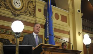 Gov. Dennis Daugaard addresses lawmakers during a special legislative session in Pierre, S.D., Wednesday, Sept. 12, 2018. Daugaard later signed into law three bills, including a measure that will allow South Dakota to start collecting sales taxes from many out-of-state online retailers this fall. (AP Photo/James Nord)