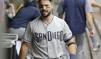 San Diego Padres' Austin Hedges walks in the dugout after he hit a two-run home run to score Eric Hosmer during the second inning of a baseball game against the Seattle Mariners, Wednesday, Sept. 12, 2018, in Seattle. (AP Photo/Ted S. Warren)