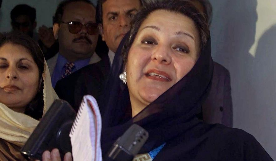 FILE - In this Dec. 9, 2000 file photo, Kulsoom Nawaz, wife of former Pakistani Prime Minister Nawaz Sharif, talks to reporters in Islamabad, Pakistan. The political party of the jailed former prime minister said his wife died before dawn Tuesday, Sept, 11, 2018, at a hospital in London after months in critical condition. She was 68. Arrangements were being made to bring her body back to Pakistan for burial. (AP Photo/B.K.Bangash, File)