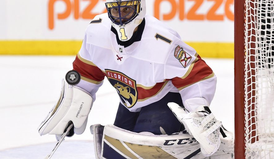 FILE - In this March 28, 2018, file photo, Florida Panthers goaltender Roberto Luongo watches the puck as a shot goes by the net during the second period of the team's NHL hockey game against the Toronto Maple Leafs, in Toronto. Luongo has made his money, knows he's headed to the Hockey Hall of Fame one day, ranks among the sport's all-time leaders in virtually every goaltending category. Yet at 39, he's still chasing the thing he wants most _ the Stanley Cup. (Frank Gunn/The Canadian Press via AP, File)