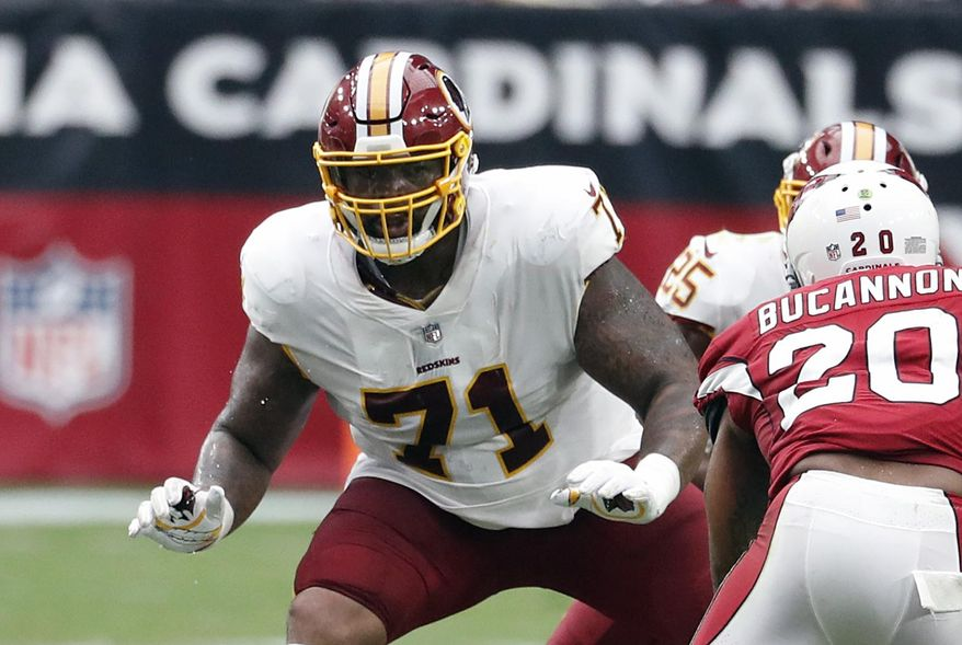 """FILE - In this Sept. 9, 2018, file photo, Washington Redskins offensive tackle Trent Williams (71) is shown in action during an NFL football game against the Arizona Cardinals, in Glendale, Ariz. A franchise known for the """"Hogs"""" offensive line from the Super Bowl era, the Washington Redskins might have another season-altering group in the trenches this season. Led by left tackle Trent Williams, Washington's """"Hogs 2.0"""" offensive line is a dream to play behind for running back Adrian Peterson and quarterback Alex Smith. (AP Photo/Rick Scuteri, File)"""