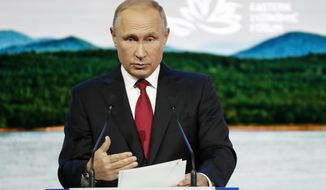 Russian President Vladimir Putin gestures as delivers a speech during a plenary session at the Eastern Economic Forum in Vladivostok, Russia, Wednesday, Sept. 12, 2018. (AP Photo/Dmitri Lovetsky)
