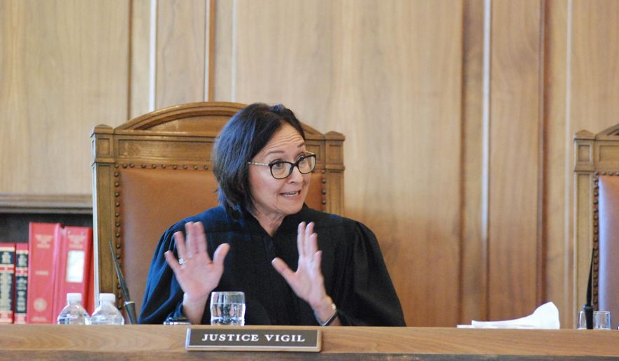 New Mexico Supreme Court Justice Barbara Vigil asks questions in Santa Fe, N.M., Wednesday, Sept. 12, 2018, during oral arguments on whether voters should be allowed to select candidates from a particular party in all races by marking a single ballot box. The New Mexico Supreme Court is blocking a ballot option that would have allowed voters to select candidates from one particular party in all races by marking a single box. The court made its decision Wednesday after listening to oral arguments about a plan from the state's top elections regulator to reinstate straight-ticket voting in the November general election. (AP Photo/Morgan Lee)
