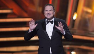 """In this March 13, 2016, file photo, Norm Macdonald begins as host of the Canadian Screen Awards in Toronto. """"The Tonight Show canceled an appearance by Macdonald after he made comments about the MeToo movement and fellow comedians Louis C.K. and Roseanne Barr. (Peter Power/The Canadian Press via AP, File)"""