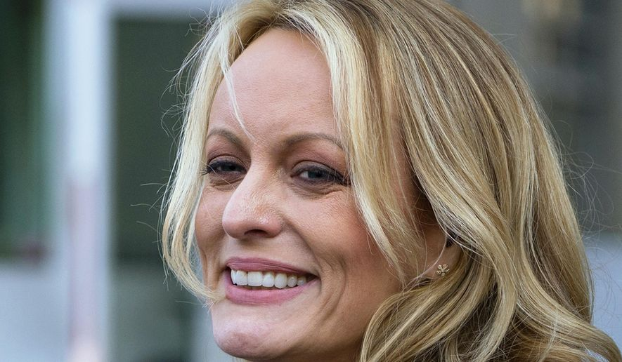 """FILE - In this April 16, 2018 file photo, adult film actress Stormy Daniels speaks to members of the media after a hearing at federal court in New York.   Daniels is telling her story in a new memoir titled """"Full Disclosure."""" The porn star who alleges an affair with President Donald Trump announced the book on ABC's """"The View"""" Wednesday.  (AP Photo/Craig Ruttle)"""