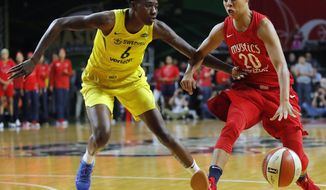 Seattle Storm forward Natasha Howard (6) defends as Washington Mystics guard Kristi Toliver (20) drives to the basket during the first half of Game 3 of the WNBA basketball finals, Wednesday, Sept. 18 2018, in Fairfax, Va. (AP Photo/Carolyn Kaster)