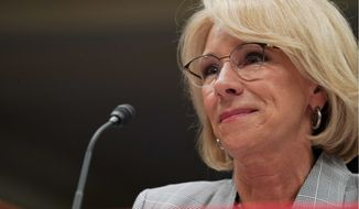 FILE - in this June 5, 2018, file photo, Education Secretary Betsy DeVos pauses as she testifies on Capitol Hill in Washington. Preliminary data obtained by The Associated Press show the Trump administration is granting only partial loan forgiveness to the vast majority of students it approves for help because of fraud by for-profit colleges. The data demonstrate the impact of DeVos new policy of tiered relief, in which students swindled by for-profit schools are compensated based on their earnings after the program. (AP Photo/Carolyn Kaster, File)