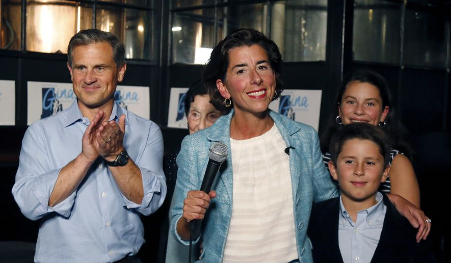 Incumbent Democratic Rhode Island Gov. Gina Raimondo speaks to supporters, alongside her husband Andrew Moffit, left, and children, Thompson and Cecilia, at her primary night victory party, Wednesday, Sept. 12, 2018, in Providence, R.I. (AP Photo/Elise Amendola)