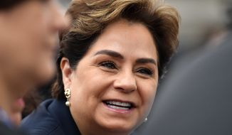 "Patricia Espinosa, executive secretary of the United Nations Framework Convention on Climate Change, smiles in the U.S. Climate Action Center during the ""AMERICA'S PLEDGE"" and ""WE ARE STILL IN"" campaign at the COP 23 Fiji UN Climate Change Conference in Bonn, Germany, Saturday, Nov. 11, 2017. (AP Photo/Martin Meissner)"