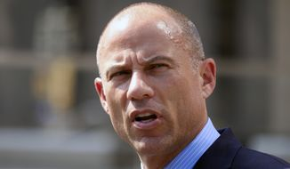 Michael Avenatti, the attorney for porn actress Stormy Daniels talks to the media during a news conference in front of the U.S. Federal Courthouse in Los Angeles on Friday, July 27,2018. (AP Photo/Richard Vogel)