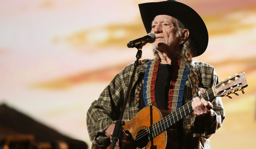 Willie Nelson performs during rehearsals for the 56th Annual Grammy Awards at The Staples Center, on Friday, Jan. 24, 2014, in Los Angeles. The Grammy Awards will take place at the Staples Center on Sunday, Jan. 26, 2014, in Los Angeles. (Photo by Matt Sayles/Invision/AP)