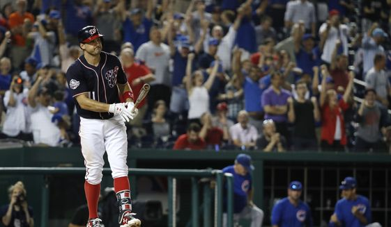 As Chicago Cubs fans celebrate behind him, Washington Nationals' Ryan Zimmerman (11) reacts after striking out in the tenth inning of a baseball game Thursday, Sept. 13, 2018, at Nationals Park in Washington. (AP Photo/Jacquelyn Martin)