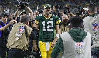 FILE - In this Sept. 9, 2018, file photo, Green Bay Packers' Aaron Rodgers walks off the field after an NFL football game against the Chicago Bears, in Green Bay, Wis. Right up until kickoff, the fans at Lambeau Field will be holding their breath to see if Aaron Rodgers can go against the Minnesota Vikings on Sunday. (AP Photo/Mike Roemer) ** FILE **