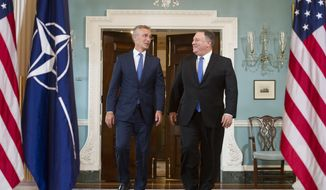 Secretary of State Mike Pompeo, right, meets with NATO Secretary General Jens Stoltenberg at the State Department in Washington, Thursday, Sept. 13, 2018. (AP Photo/Cliff Owen)