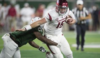 Arkansas quarterback Cole Kelley avoids a tackle by Colorado State linebacker Trey Sutton during the first half of an NCAA college football game Saturday, Sept. 8, 2018, in Fort Collins, Colo. (Austin Humphreys/Fort Collins Coloradoan via AP)