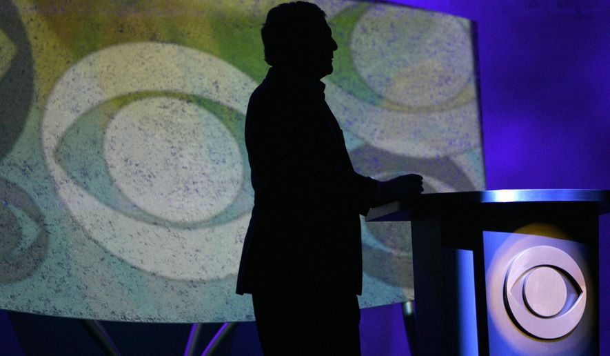 FILE- In this Jan. 9, 2007, file photo Leslie Moonves, president and CEO of CBS Corp., is silhouetted while watching a video presentation during his keynote speech at the Consumer Electronics Show in Las Vegas. Moonves, who was ousted over the weekend as head of CBS Corp. amid a continuing  investigation into allegations of sexual misconduct, began working as CBS entertainment division president in 1995 and built the network into the corporation's profitable crown jewel. (AP Photo/Jae C. Hong, File)